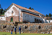 A whitewashed church is built on Inca ruins at Chincheros (30 km from Cuzco), Peru, South America. Chincheros is capital of Chincheros province in the region Apurímac, on an Andean plain at an elevation of 3762 meters.