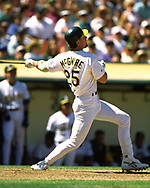 OAKLAND - 1995:  Mark McGwire of the Oakland Athletics bats during an MLB game at the Oakland Coliseum in Oakland, California during the 1995 season. (Photo by Ron Vesely) Subject:   Mark McGwire