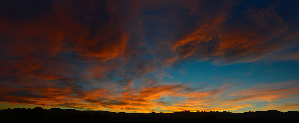 Panorama of sunset over the Front Range of the Colorado Rocky Mountain Range.