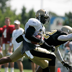 August 2, 2010; Metairie, LA, USA; New Orleans Saints running back Reggie Bush (25) spins away for linebacker Jonathan Casillas (52) during a training camp practice at the New Orleans Saints practice facility. Mandatory Credit: Derick E. Hingle