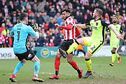 Exeter City goalkeeper Christy Pym (1) makes a save from Lincoln City forward Matt Green (10)  during the EFL Sky Bet League 2 match between Lincoln City and Exeter City at Sincil Bank, Lincoln, United Kingdom on 30 March 2018. Picture by Mick Atkins.