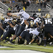 ORLANDO, FL - NOVEMBER 21:  Desmond Ridder #9 of the Cincinnati Bearcats leaps for a touchdown against the Central Florida Knights at Bounce House-FBC Mortgage Field on November 21, 2020 in Orlando, Florida. (Photo by Alex Menendez/Getty Images) *** Local Caption *** Desmond Ridder