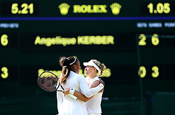 Serena Williams and Angelique Kerber embrace after their match on day twelve of the Wimbledon Championships at the All England Lawn Tennis and Croquet Club, Wimbledon.