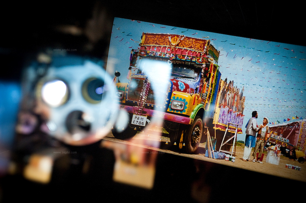 A decorated truck is featured in the Bollywood movie 'Dil Bole Hadippa' (2009, Yash Raj films) seen from the projection room of a cinema hall in Noida (UP). The movie projector is reflected in the glass window of the projection room. September 2009