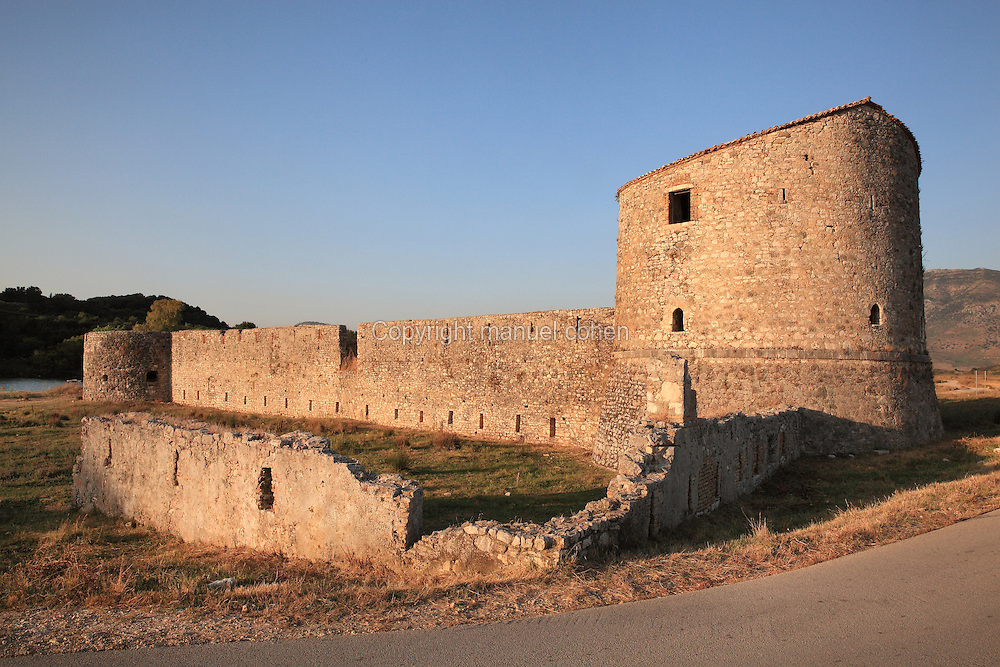 Tower and walls of the Triangular Fortress, built by the Venetians in late 15th - early 16th century, Butrint, Chaonia, Albania. The venetians re-fortified Butrint to protect their valuable mainland resources, first building the Triangular fortress and then massive square blockhouse, known now as the Venetian Tower. Venice capitulated to Napoleon Bonaparte in 1797, when Butrint fell into the hands of the infamous local despot Ali Pasha of Tepelena. Butrint was founded by the Greek Chaonian tribe and was a port throughout Hellenistic and Roman times, when it was known as Buthrotum. It was ruled by the Byzantines and the Venetians and finally abandoned in the Middle Ages. The ruins at Butrint were listed as a UNESCO World Heritage Site in 1992. Picture by Manuel Cohen