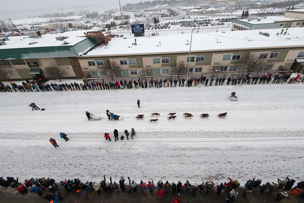 A musher leads a team down 4th Avenue in Anchorage, Alaska during the ceremonial start of the 2020 Iditarod.