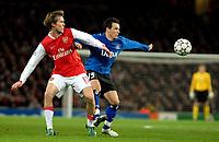 Photo: Ed Godden.<br /> Arsenal v Hamburg. UEFA Champions League, Group G. 21/11/2006. Arsenal's Alexander Hleb (L) is challenged by Piotr Trochowski.