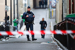 © Licensed to London News Pictures. 16/11/2015. Paris, France. French police patrolling on the side street of  Bataclan Cafe in Paris, France following the Paris terror attacks on Monday, 16 November 2015. Photo credit: Tolga Akmen/LNP