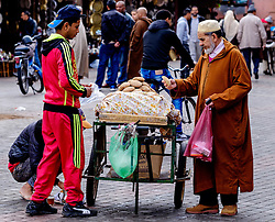 A man buying bread from a portable stall in the medina in Marrakech, Morocco, North Africa<br /> <br /> (c) Andrew Wilson   Edinburgh Elite media