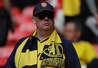 Arsenal fan watches the teams warm up <br /> <br /> Photographer Ashley Crowden/CameraSport<br /> <br /> Football - The FA Cup Final - Aston Villa v Arsenal - Saturday 30th May 2015 - Wembley - London<br /> <br /> © CameraSport - 43 Linden Ave. Countesthorpe. Leicester. England. LE8 5PG - Tel: +44 (0) 116 277 4147 - admin@camerasport.com - www.camerasport.com
