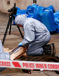 ©London News Picures. 13/01/11 Forensic Support Police Officers putting evidence into an evidence bag at the Accessorize store in Regent Street, London UK, today (Thurs) after a man broke into the store overnight in central London and threatened to blow himself up. Photo credit should read Craig Shepheard / London News Pictures