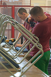 A prisoners making prison chairs in a prison workshop at HMP Feathstone