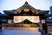 tourist taking a picture of the Yasukuni Shrine Tokyo Japan