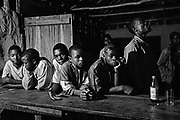 Young men line up at the bar in Mabote, Mozambique. UNAIDS estimates that people aged under 25 years, account for half of all new HIV infections.