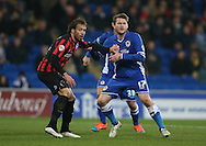 Aron Gunnarsson and Inigo Calderon, Brighton defender during the Sky Bet Championship match between Cardiff City and Brighton and Hove Albion at the Cardiff City Stadium, Cardiff, Wales on 10 February 2015.