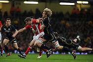Rhys Priestland of Wales is tackled by Scotland's Richie Gray. RBS Six nations championship 2012, Wales v Scotland at the Millennium Stadium in Cardiff on Sunday 12th Feb 2012.  pic by Andrew Orchard, Andrew Orchard sports photography,