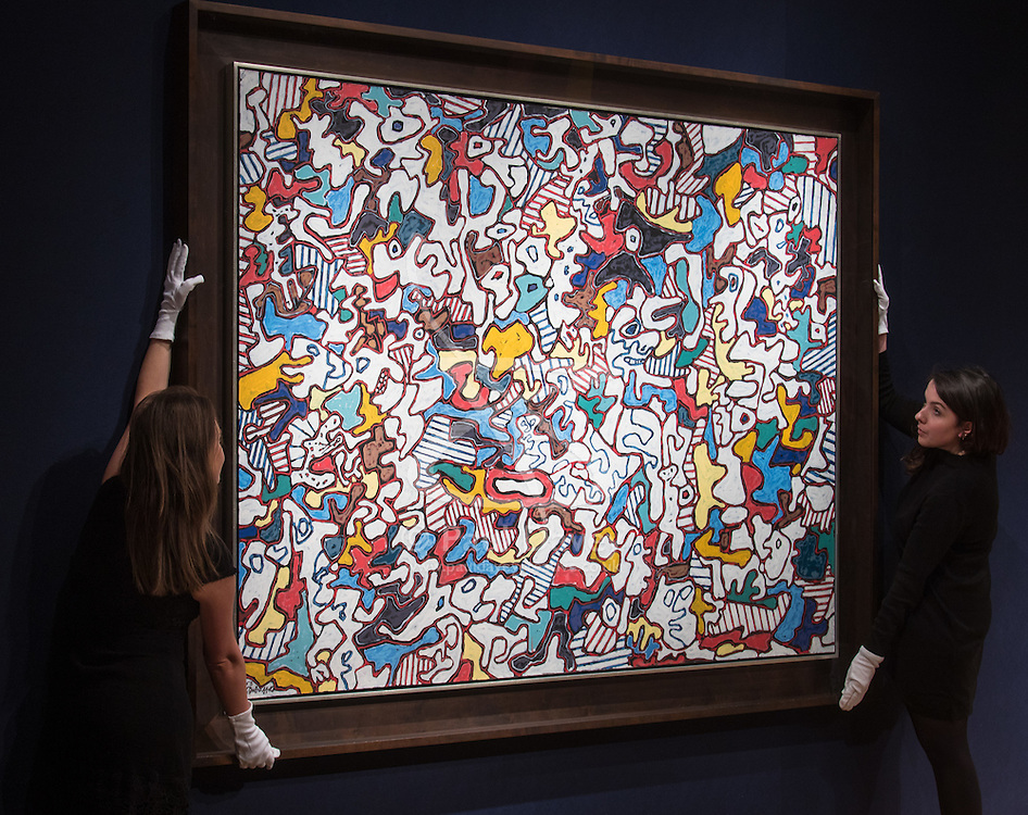 Christie's, London, March 3rd 2017. PICTURED: Gallery workers straighten Jean Dubuffet's Étra et paraitre (To Be and To Seem), oil on canvass, which is expected to fetch between £7-10 million. <br /> Fine art auctioneers Christies hold a press preview for their Post-War and Contemporary Art auctions to be held on March 7th and 8th.
