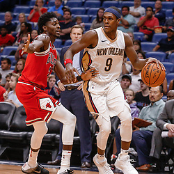 Oct 3, 2017; New Orleans, LA, USA; New Orleans Pelicans guard Rajon Rondo (9) drives past Chicago Bulls guard Justin Holiday (7) during a NBA preseason game at the Smoothie King Center. The Bulls defeated the Pelicans 113-109. Mandatory Credit: Derick E. Hingle-USA TODAY Sports