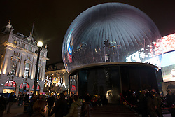 © Licensed to London News Pictures.18/11/2013. London, UK. A 30ft snow globe covers the Eros statue to protect the famous Grade I listed statue from vandalism during the Christmas party season at Picadilly Circus.Photo credit : Peter Kollanyi/LNP