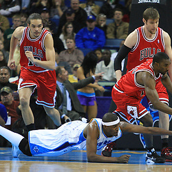 04 February 2009: New Orleans Hornets forward James Posey (41) and Chicago Bulls guard Ben Gordon (7) scramble for a loose ball during a 93-107 loss by the New Orleans Hornets to the Chicago Bulls at the New Orleans Arena in New Orleans, LA.