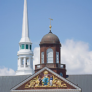 Pediment and cupola on the City Hall municipal building and the clock on the Congregational Church steeple.  Ellsworth, Maine