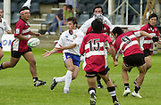 Oxford, England.<br /> <br /> IRB U21 Rugby World Cup - Iffley Road - Oxford <br /> 21.06.2003. Italy vs Japan, [Mandatory Credit: Peter SPURRIER/Intersport Images]  <br /> Valerio Santillo breaks through the Japanese defence