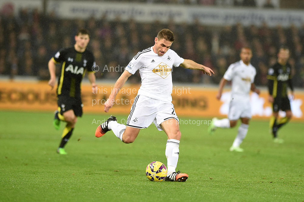 Angel Rangel of Swansea city in action. Barclays Premier League match, Swansea city v Tottenham Hotspur at the Liberty Stadium in Swansea, South Wales on Sunday 14th December 2014<br /> pic by Andrew Orchard, Andrew Orchard sports photography.