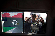 Mcc0030300 . Daily Telegraph..A rebel fighter peers through a van window at the West Gate of Ajdabiyah..Ajdabiyah 31 March 2011