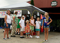 """A last minute change due to the unavailability of seeded watermelon didn't stop these children from lining up for the """"cherry seed"""" spitting contest at the Belmont 4H Fair on Saturday afternoon.  (Karen Bobotas/for the Laconia Daily Sun)"""