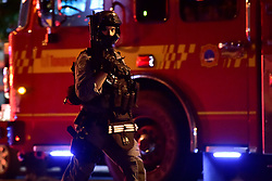 A tactical officer is seen at the scene of a mass casualty incident in Toronto, ON, Canada on Sunday, July 22, 2018. A young woman has been killed and 13 others injured in a shooting incident in Toronto, Canadian police say. The Sunday night shooting happened in the Danforth and Logan avenues area. The gunman died in an exchange of fire. Among those injured is a young girl, described as in a critical condition. Police are appealing for witnesses. Photo by Frank Gunn/ABACAPRESS.COM
