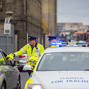 14.11.2016          <br /> Major winter safety and wellbeing campaign launched by Limericks Public Services.<br /> <br /> Garda Brian O'Dwyer and Garda Aidan O'Gorman, Limerick Traffic Corps hand out High Visability Jackets and information leaflets during a combined checkpoint between Limerick City and County Council, the HSE and An Garda Siochana on the Dock Road Limerick. Picture: Alan Place.
