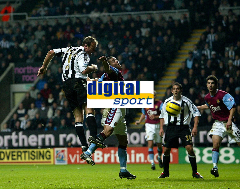 Photo: Andrew Unwin.<br />Newcastle Utd v Aston Villa. The Barclays Premiership.<br />03/12/2005.<br />Newcastle's Alan Shearer (L) attempts to direct his header goalwards.