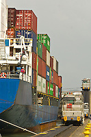 Container ship pulled by locomotive passes through the Miraflores Locks on the Panama Canal, Panama