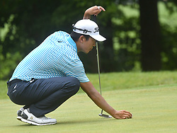 July 15, 2018 - Silvis, Illinois, U.S. - SILVIS, IL - JULY 15:  Michael Kim places his ball before ;putting on the #6 green during the final round of the John Deere Classic on July 15, 2018, at TPC Deere Run, Silvis, IL.  (Photo by Keith Gillett/Icon Sportswire) (Credit Image: © Keith Gillett/Icon SMI via ZUMA Press)