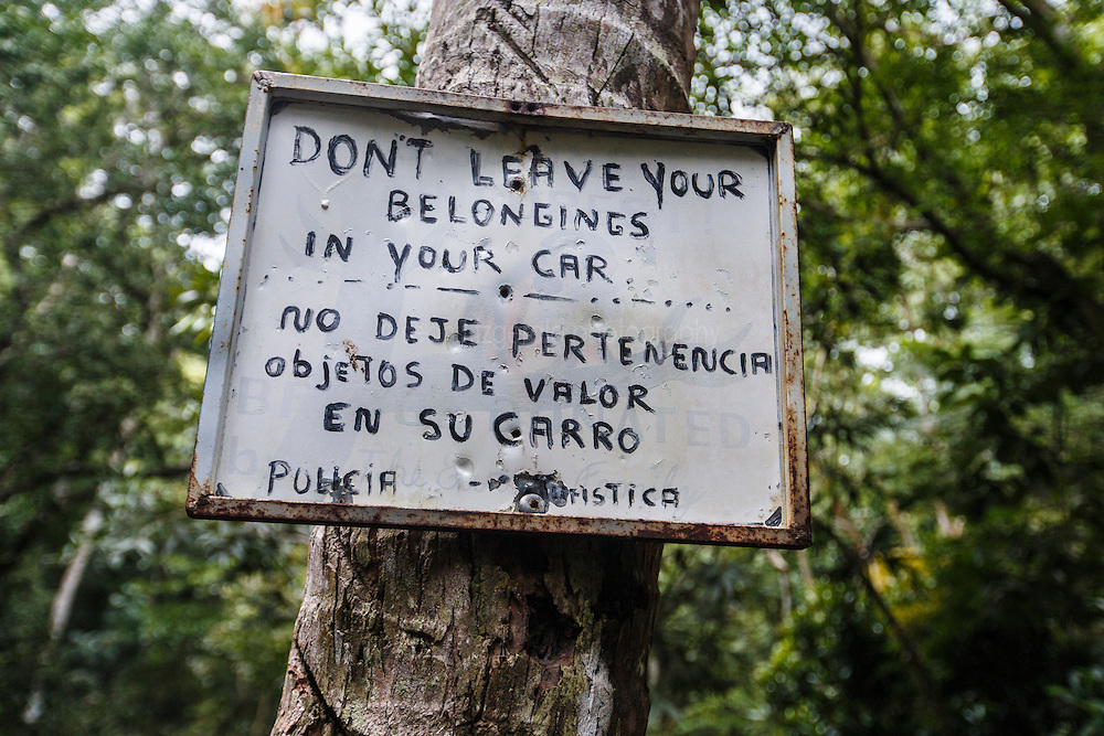 """Warning sign (""""Don't Leave Belongings in Your Car"""") on  Biesanz Beach near Manuel Antonio National Park, Costa Rica."""