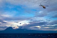 Maluku, Central Maluku, Buru. Helicopter on its way to Buru. East coast of the island.