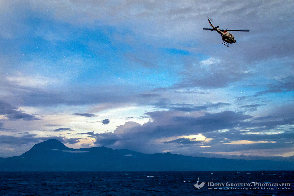 Maluku, Central Maluku, Buru. Helicopter on its way to Buru. East coast of the island.