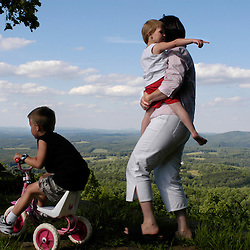 """Blue Ridge Parkway, Roanoke, VA-- """"It was here that Mommy and Daddy got engaged,"""" Tara Underwood told her 3 year-old daughter Bailey, during a visit by the family at the park called """"the Saddle"""" near Roanoke off the Blue Ridge Parkway. Older brother Brady, 6, takes off in his little sister's tricycle ahead of the pair.  (EDS note: Tara Underwood @ 540.745.3739)"""