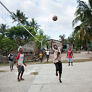 """Youths playing volley ball. Many were trouble makers in the past but have been through a conflict resolution workshop run by Angel from BA Futuru. BA Futuru means """"for the sake of the future"""" in Tetun, the national language in Timor Leste. BA Futuru grew out of the fightings in 2006 where civil unrest and infighting between police and army caused massive damages and thousands of killed."""