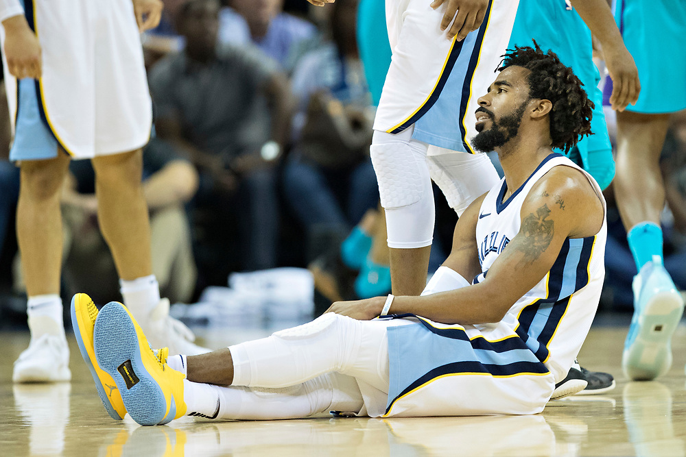 MEMPHIS, TN - OCTOBER 30:  Mike Conley #11 of the Memphis Grizzlies sits on the floor near the end of the game during a game against the Charlotte Hornets at the FedEx Forum on October 30, 2017 in Memphis, Tennessee.  NOTE TO USER: User expressly acknowledges and agrees that, by downloading and or using this photograph, User is consenting to the terms and conditions of the Getty Images License Agreement.  The Hornets defeated the Grizzlies 104-99.  (Photo by Wesley Hitt/Getty Images) *** Local Caption *** Mike Conley