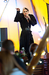 © Licensed to London News Pictures. 03/06/2016. Hay-on-Wye, Powys, Wales, UK. Joe Black - hailed as the king of comedy noir - shocks some of the audience with his act as evening entertainment gets under way on the ninth day of 'HowTheLightGetsIn' Festival of Ideas - The philosophy and music festival at Hay-on-Wye, Wales, UK. HowTheLightGetsIn festival was founded by post-realist philosopher and director of the Institute of Art and Ideas, Hilary Lawson. Photo credit: Graham M. Lawrence/LNP