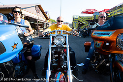 Jody Perewitz, Dave Perewitz and Lora Wilkinson after the Perewitz Paint Show at the Iron Horse Saloon during the Sturgis Motorcycle Rally. Sturgis, SD, USA. Wednesday, August 11, 2021. Photography ©2021 Michael Lichter.