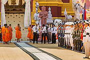 """04 FEBRUARY 2013 - PHNOM PENH, CAMBODIA: Cambodian Buddhist monks file into the cremation venue for the cremation of King-Father Norodom Sihanouk in Phnom Penh. Norodom Sihanouk (31 October 1922- 15 October 2012) was the King of Cambodia from 1941 to 1955 and again from 1993 to 2004. He was the effective ruler of Cambodia from 1953 to 1970. After his second abdication in 2004, he was given the honorific of """"The King-Father of Cambodia."""" Sihanouk died in Beijing, China, where he was receiving medical care, on Oct. 15, 2012.    PHOTO BY JACK KURTZ"""