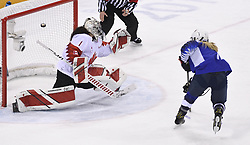 February 22, 2018 - Pyeongchang, South Korea - USA's MONIQUE LAMOUREUX-MORANDO scores past Canada goalie SHANNON SZABADOS to tie the game 2-2 in the third period of the Women's Gold Medal Ice Hockey game Thursday, February 22, 2018 at Gangneung Hockey Centre at the Pyeongchang Winter Olympic Games. Photo by Mark Reis, ZUMA Press/The Gazette (Credit Image: © Mark Reis via ZUMA Wire)