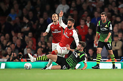 Arsenal's Olivier Giroud (top) and Doncaster Rovers' Ben Whiteman (bottom) battle for the ball during the Carabao Cup, Third Round match at the Emirates Stadium, London.