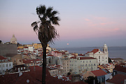 View from  Portas do Sol belvedere to Alfama district and a magnificent full moonrise over the Tagus river, on the way of Lisbon's nº28 yellow tram, through the central, most historic region of the city.