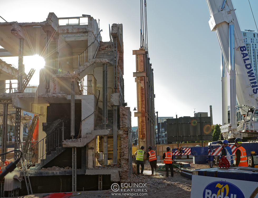 London, United Kingdom - 20 September 2019<br /> EXCLUSIVE SET - Aerial construction specialists and demolition experts use a huge crane to carefully lift intact, a twenty five ton, two-story wall, to preserve a famous Banksy rat image which has been covered up for years. Teams from specialist companies have spent over six weeks cutting around the artwork and fitting custom made eight ton steel supports to enable them to save the historic piece of art. Work has started on the construction of a new twenty seven floor art'otel hotel on the site of the old Foundry building in Shoreditch, east London, and a condition of the planning permission was to preserve the historical Banksy graffiti. A second section of the painting, an image of a TV being thrown through a broken window has already been cut out and moved separately. After the hotel construction is complete the two parts of the Banksy painting will be displayed on the hotel. Our pictures show the stages of work to protect the image, culminating in the lifting of the three story wall by crane. Video footage also available.<br /> (photo by: EQUINOXFEATURES.COM)<br /> Picture Data:<br /> Photographer: Equinox Features<br /> Copyright: ©2019 Equinox Licensing Ltd. +443700 780000<br /> Contact: Equinox Features<br /> Date Taken: 20190920<br /> Time Taken: 17132959<br /> www.newspics.com
