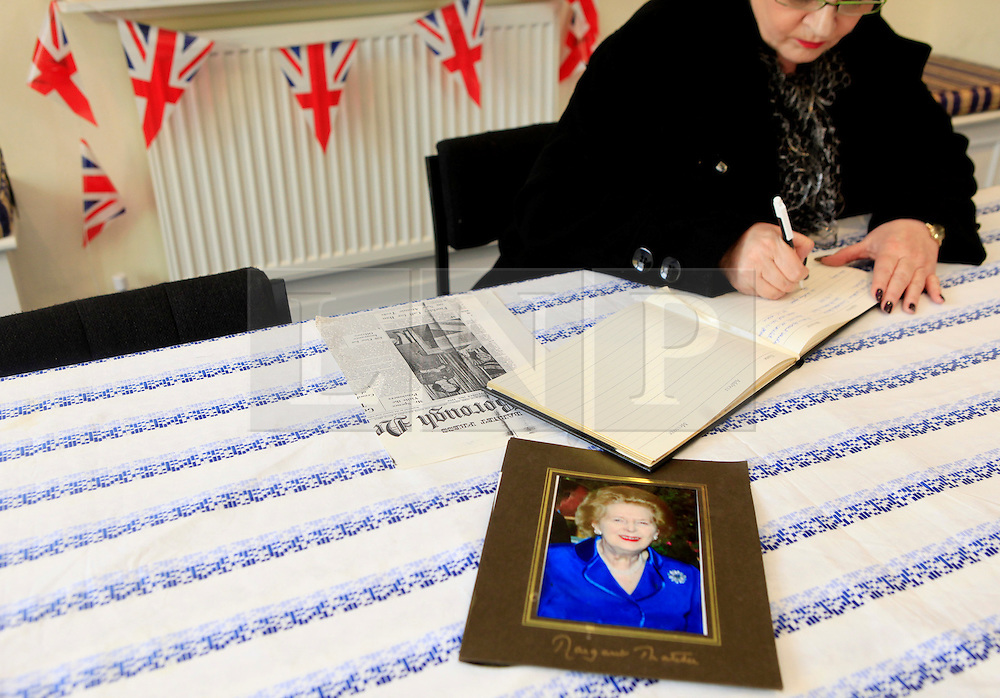 © Licensed to London News Pictures 10/04/2013.A resident of Finchley signs the condolence book, following the death of Margaret Thatcher, at Finchley Conservatives Association in north London..London, UK.Photo credit: Anna Branthwaite