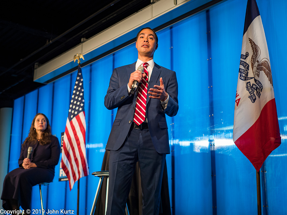 """10 DECEMBER 2019 - DES MOINES, IOWA: JULIÁN CASTRO, right, former Secretary of Housing and Urban Development in the Obama Administration, and LAURA BELIN, left, publisher of the Bleeding Heartland, a blog about Iowa Democratic politics, talk about Castro's presidential campaign and Iowa's role as """"First in the Nation"""" during a town hall meeting at Drake University in Des Moines. In recent weeks, Castro has been critical of the outsize role Iowa and New Hampshire play in the presidential selection process. His town hall tonight was to specifically discuss Iowa's role in the presidential selection process. Castro is visiting Iowa to support his bid to be the Democratic nominee for the US Presidency. Iowa traditionally hosts the the first selection event of the presidential election cycle. The Iowa Caucuses will be on Feb. 3, 2020. In recent weeks, Castro has been critical of the outsize role Iowa and New Hampshire plays in the presidential selection process.          PHOTO BY JACK KURTZ"""