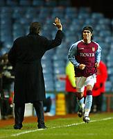 Photograph: Scott Heavey.<br /> Aston Villa v Portsmouth. FA Barclaycard Premiership. 06/01/2003.<br /> Juan Pablo Angel celebrates with manager David O'Leary after putting Villa 1-0 ahead.